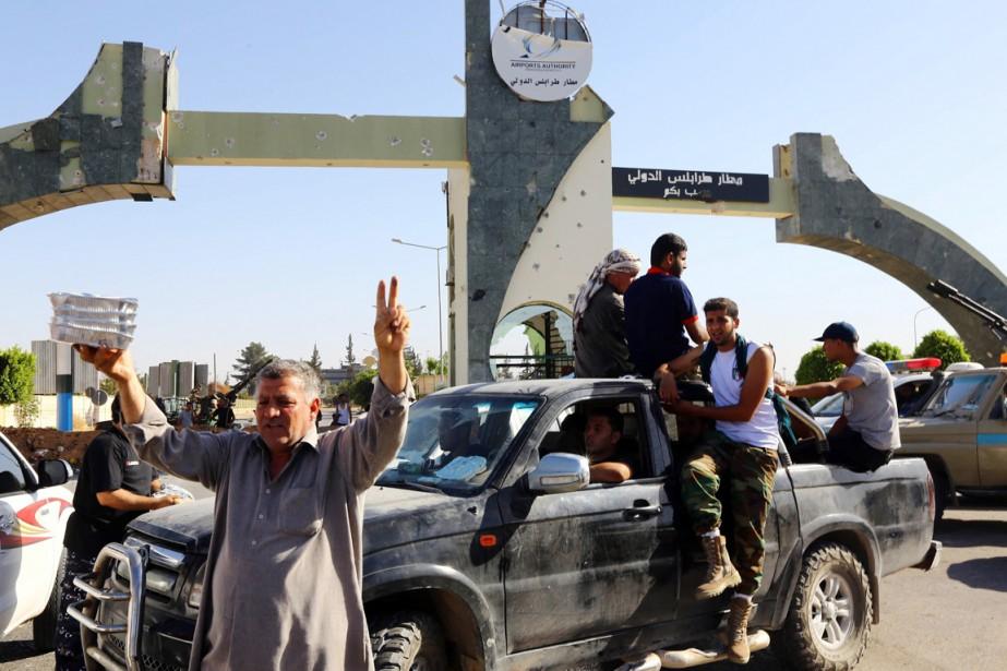 Fajr Libya, une coalition de milices islamistes et... (PHOTO MAHMUD TURKIA, ARCHIVES AFP)