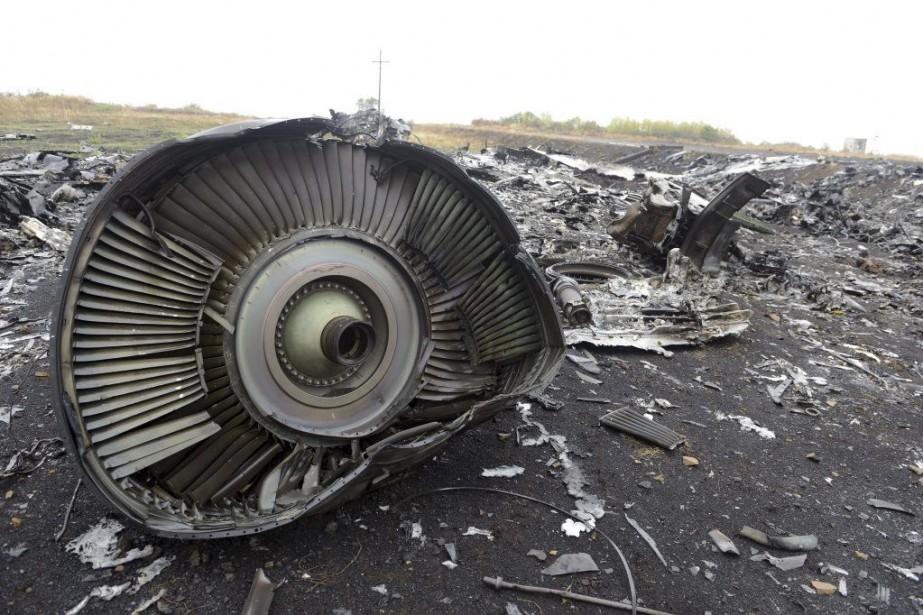 Des débris du vol MH17... (PHOTO ALEXANDER KHUDOTEPLY, ARCHIVES AGENCE FRANCE-PRESSE)