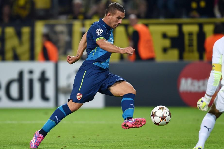 Lukas Podolski... (Photo Patrik Stollarz, archives AFP)