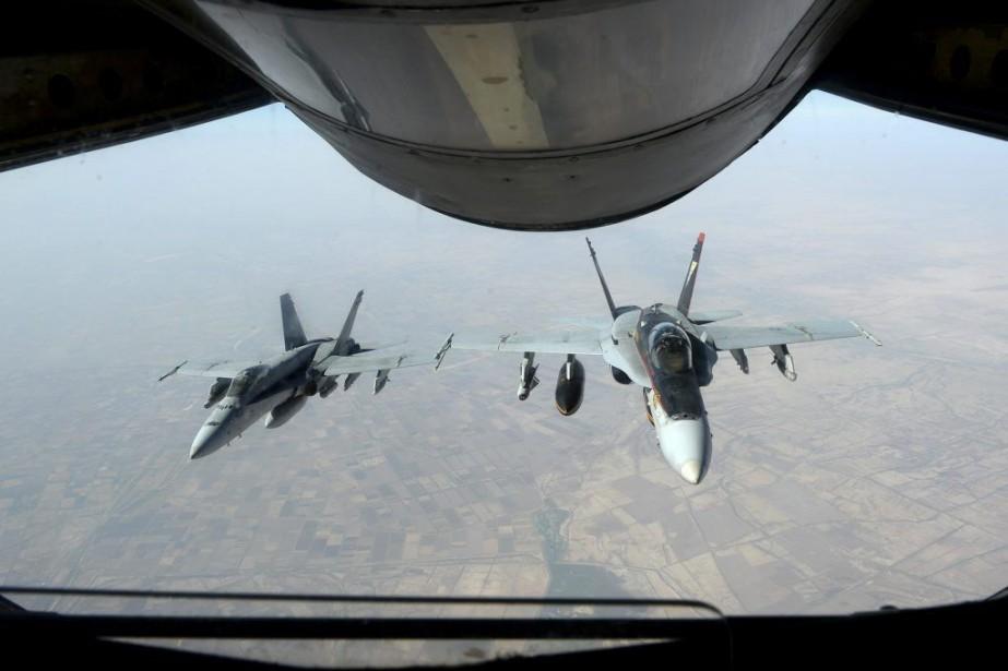 Les États-Unis ont commencé à effectuer des frappes... (PHOTO AFP)