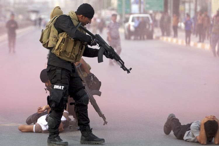 Selon Amnesty International, les milices chiites se servent... (Photo: Reuters)
