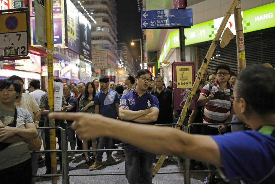 Dans la rue depuis un mois, les manifestants... (Photo Vincent Yu, AP)