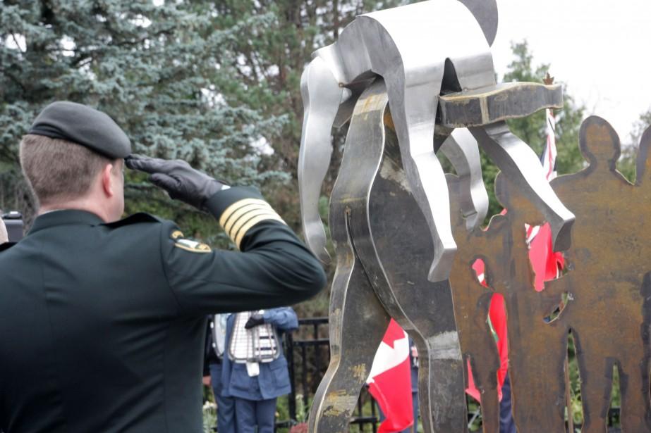 Une sculpture centrale montre dans le parc un... (Photo Colin Perkel, La Presse Canadienne)