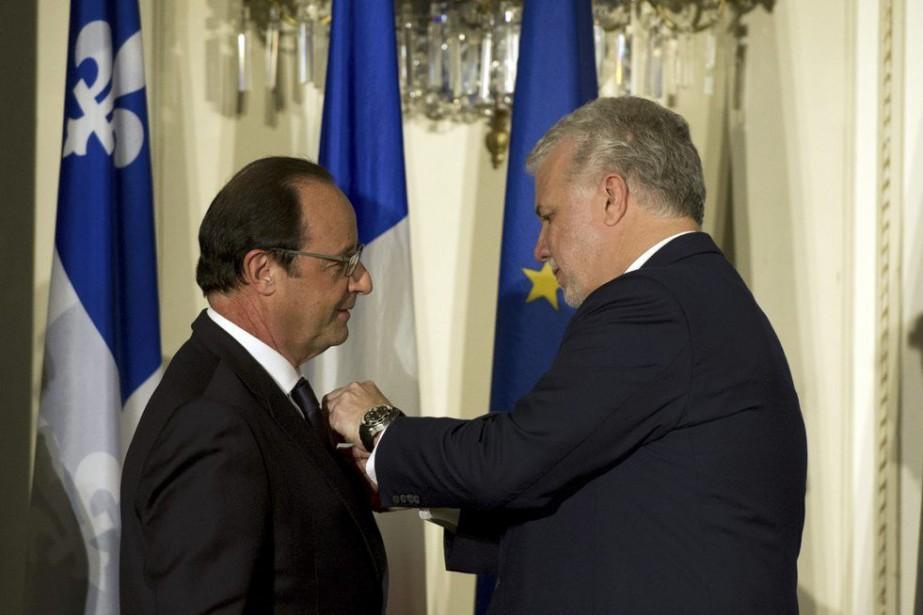 Le président français François Hollande a reçu l'Ordre... (PHOTO ALAIN JOCARD, AGENCE FRANCE-PRESSE)