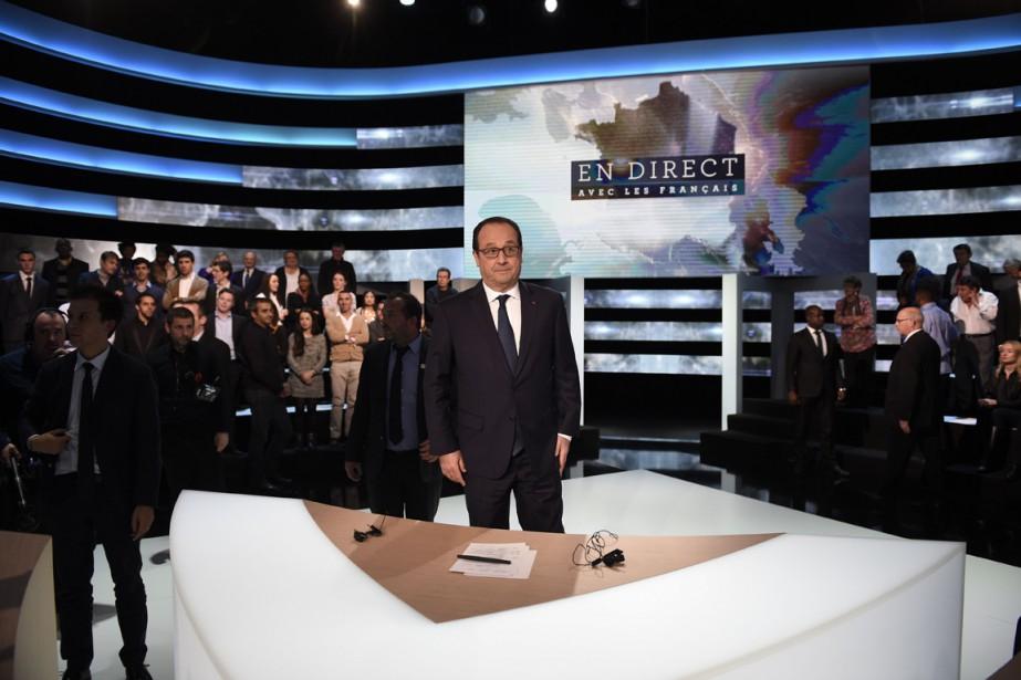 Au plus bas dans les sondages, le président... (PHOTO MARTIN BUREAU, AFP)