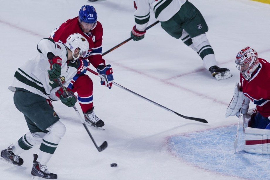 Markov tente d'arrêter l'attaquant du Wild. (PHOTO EDOUARD PLANTE-FRECHETTE, LA PRESSE)