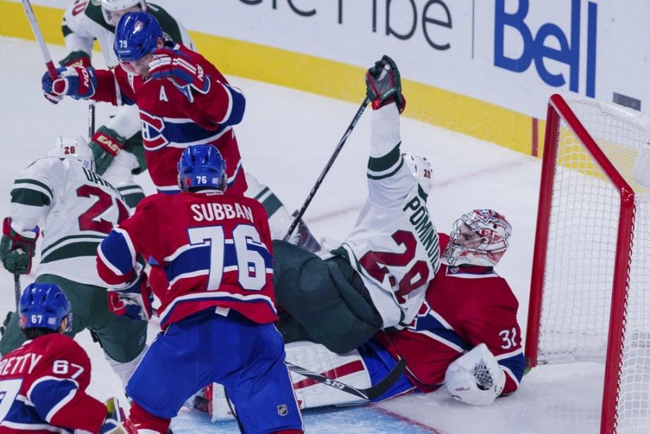 Carey Price se fait écraser par son adversaire. (PHOTO EDOUARD PLANTE-FRECHETTE, LA PRESSE)