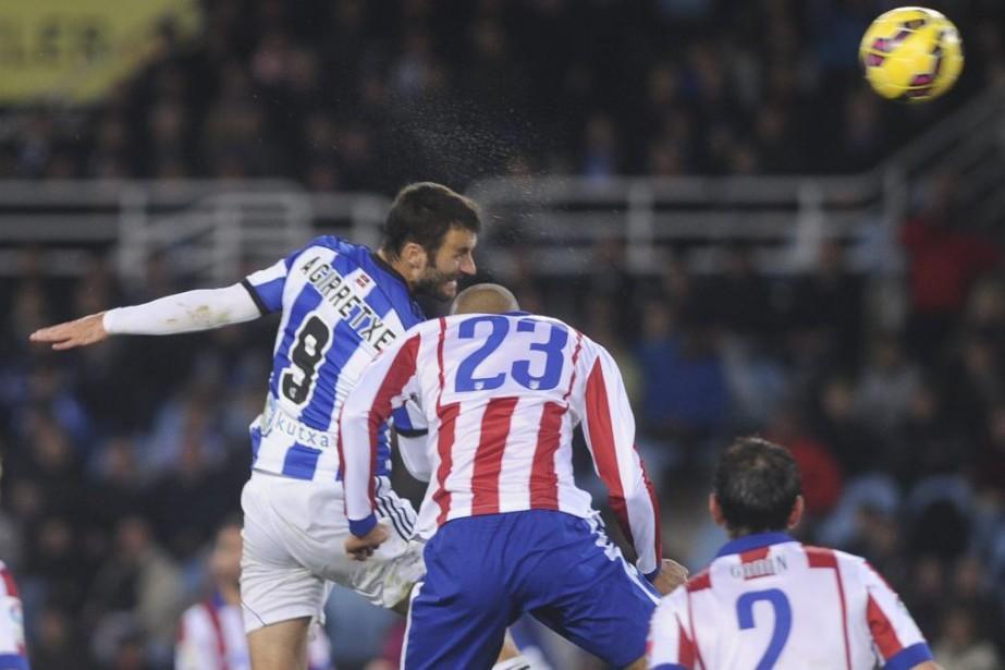 L'Atletico Madrid, réduit à dix, a calé dimanche devant la Real... (Photo: AFP)