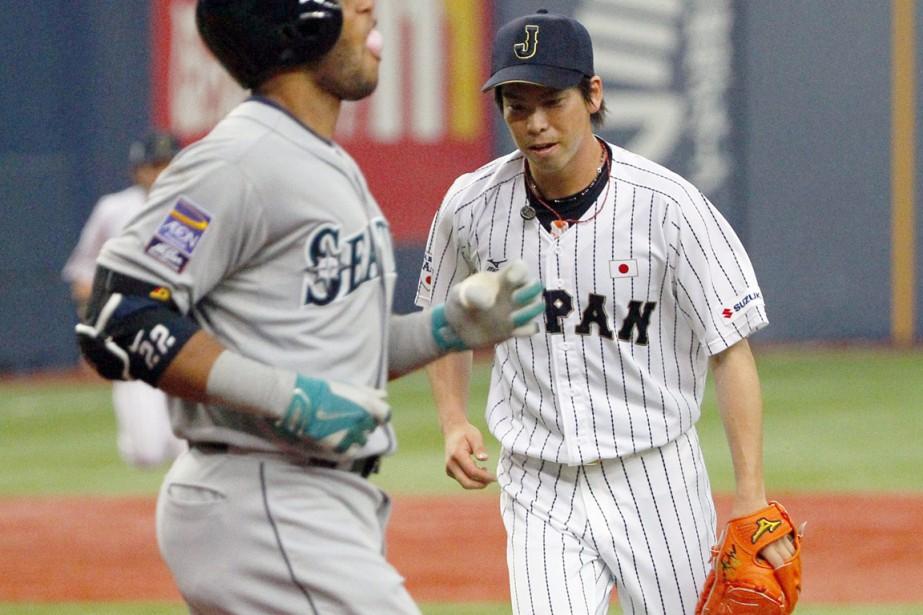 Le lanceur japonais Kenta Maeda n'a accordé que... (Photo AP)