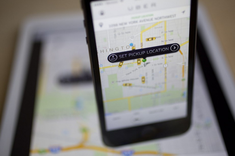 Uber, qui permet à ses clients grâce à... (Photo Andrew Harrer/Bloomberg)