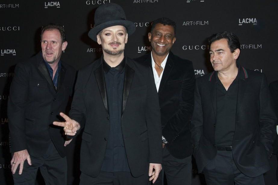Boy George (2e à gauche) en compagnie des... (Photo: archives AFP)