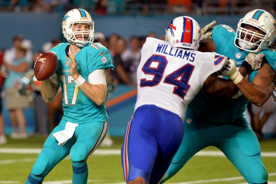Ryan Tannehill (à gauche) a complété 26 de... (Photo Steve Mitchell, USA Today Sports)