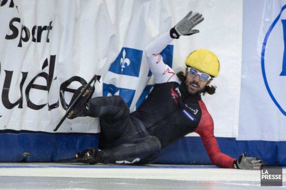 Charles Hamelin a chuté en toute fin de... (Photo Paul Chiasson, La Presse Canadienne)