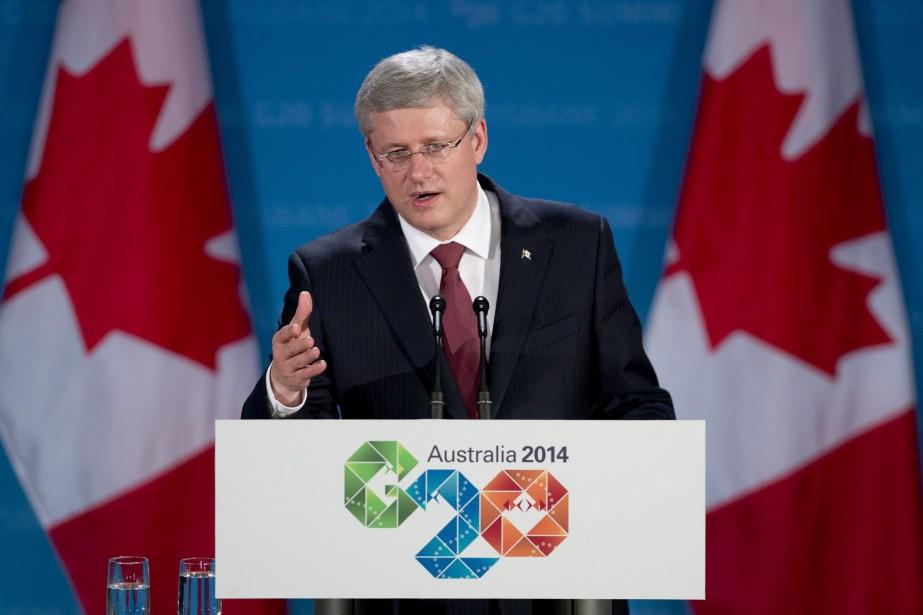 Stephen Harper a demandé à Vladimir Poutine lors... (Photo Adrian Wyld, La Presse Canadienne)