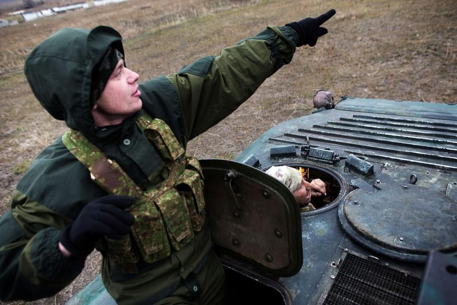 Les autorités ukrainiennes et les rebelles... (Photo MENAHEM KAHANA, AFP)