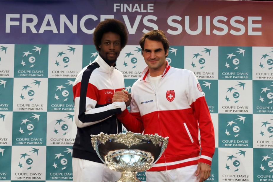 Gaël Monfils etRoger Federer... (Photo Pascal Rossignol, Reuters)