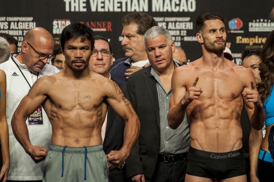 Manny Pacquiao (gauche) etChris Algieri (droite)... (Photo XAUME OLLEROS, AFP)