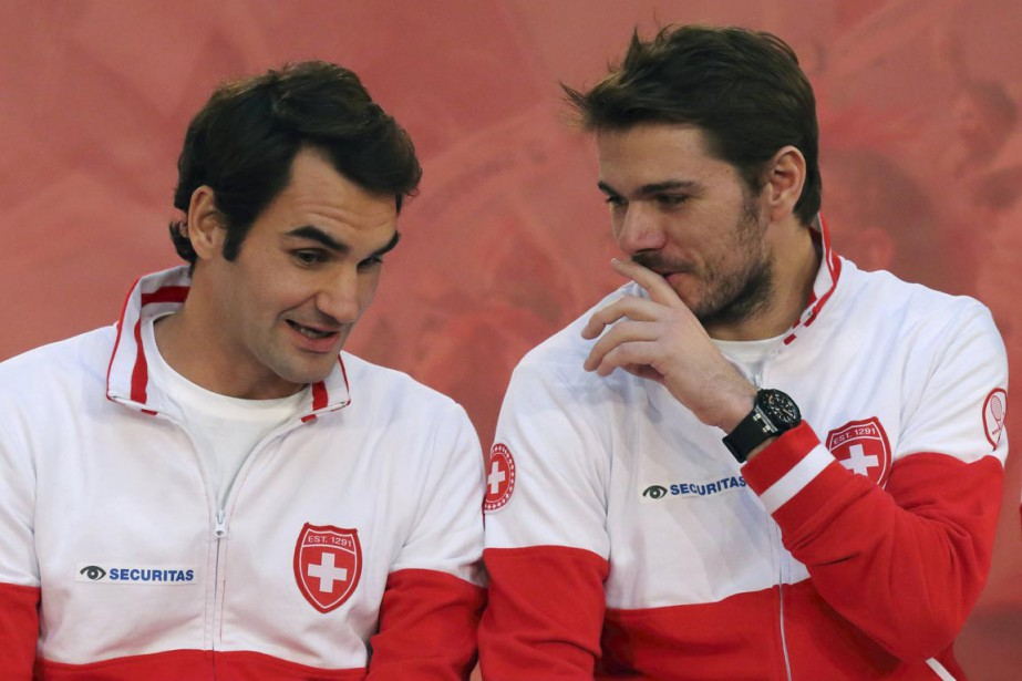 RogerFederer(à gauche) et StanislasWawrinka.... (PHOTO PASCAL ROSSIGNOL, REUTERS)