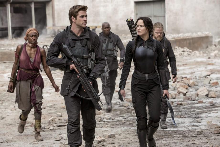 Liam Hemsworth etJennifer Lawrence dans The Hunger Games:... (PHOTO AP/LIONSGATE)