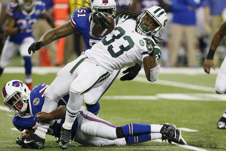 Kyle Orton a réussi deux passes de touché alors que les Bills de... (Photo: AP)