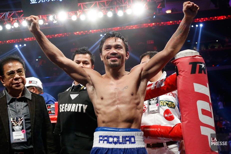 Manny Pacquiao a conservé la ceinture WBO des... (Photo Kin Cheung, AP)