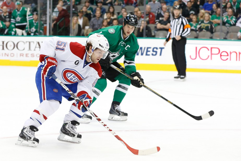 L'attaquant du Canadien David Desharnais protège la rondelle devant le joueur des Stars Jamie Benn. (Photo Tim Heitman, USA TODAY)