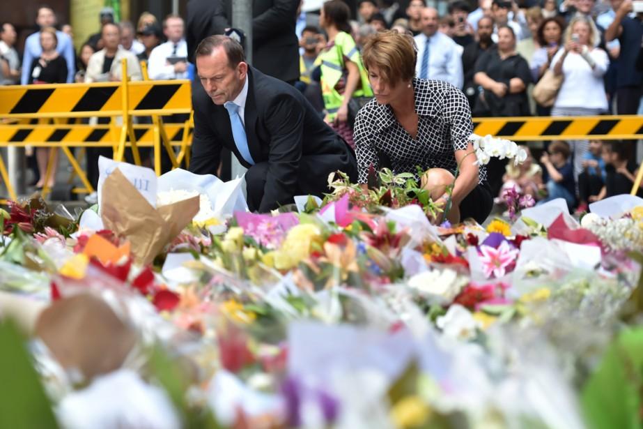 Le premier ministre australien Tony Abbott et sa... (PHOTO PETER PARKS, AFP)