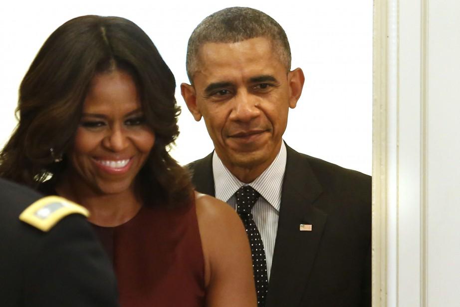 Michelle Obama aux côtés de son mari, le... (PHOTO YURI GRIPAS, REUTERS)