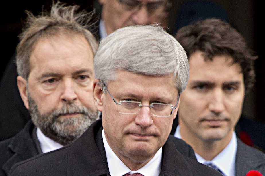 Les chefs du NPD, Thomas Mulcair (à gauche)... (PHOTO ARCHIVES LA PRESSE CANADIENNE)