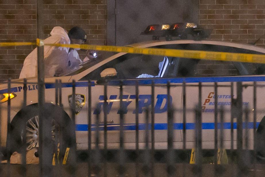 Deux policiers new-yorkais ont été abattus le 20... (Photo John Minchillo, AP)