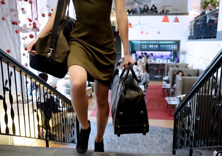 Les sacs de voyages griffés Longchamp suivent également les tendances du moment. (Le Soleil, Erick Labbé)