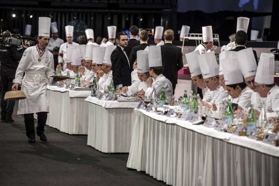 Le concours des Bocuse d'or est une compétition de haute voltige gastronomique qui prend des airs de jeux sportifs. (Photo JEAN-PHILIPPE KSIAZEK, AFP)