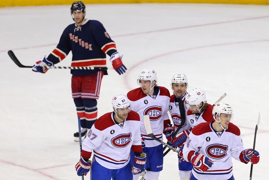 Le joueurs du Canadien festoient après le seul but marqué de la rencontre. (Photo Adam Hunger, USA Today)