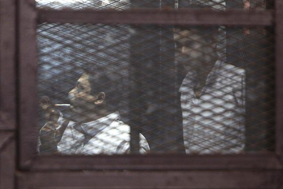 Des partisans des Frères musulmans accusés d'avoir tué... (Photo MOHAMED ABD EL GHANY, Reuters)