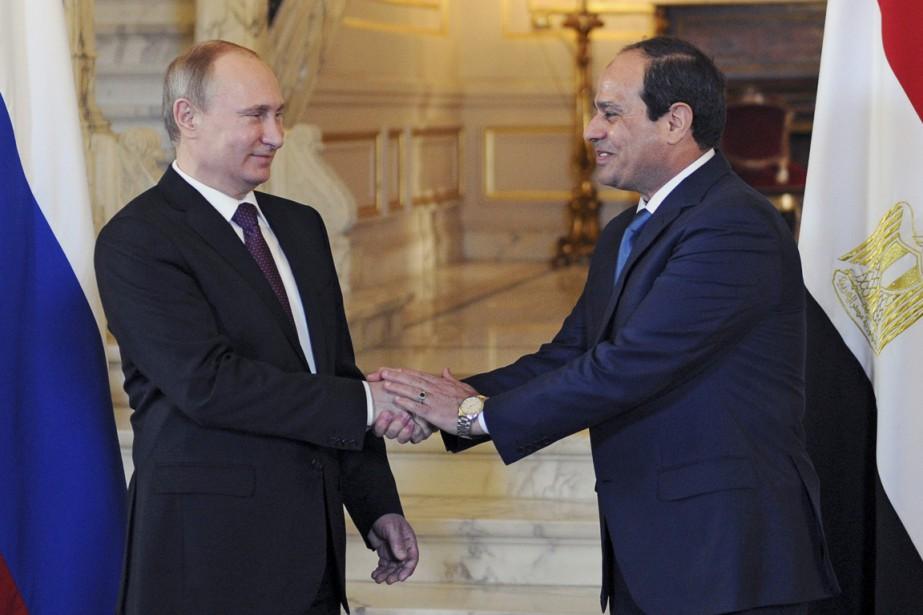 Le président russe (à gauche), soutien dès la... (PHOTO MIKHAIL KLIMENTYEV, REUTERS/RIA NOVOSTI)