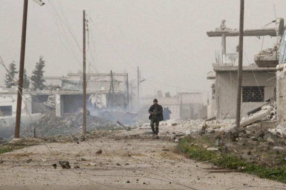 Un membre des forces du gouvernement syrien, à... (Photo AFP)