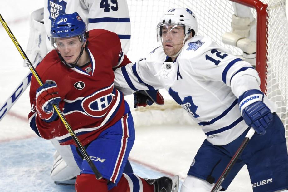 Christian Thomas des Canadien et Stephane Robidas des Maple Leafs, deuxième période. (Photo Bernard Brault, La Presse)