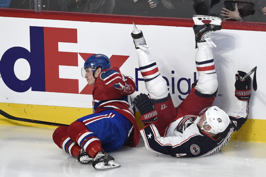 Brendan Gallagher entre solidement en contact avec le défenseur des Blue Jackets Kevin Connauton (PHOTO BERNARD BRAULT, LA PRESSE)