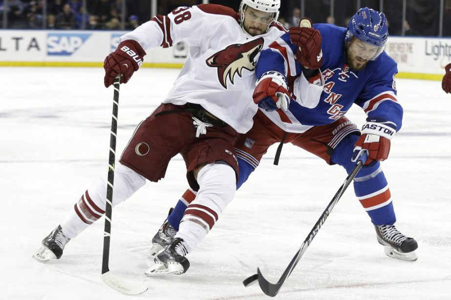 Arizona Coyotes' Lucas Lessio (38) and New York... (Frank Franklin II)