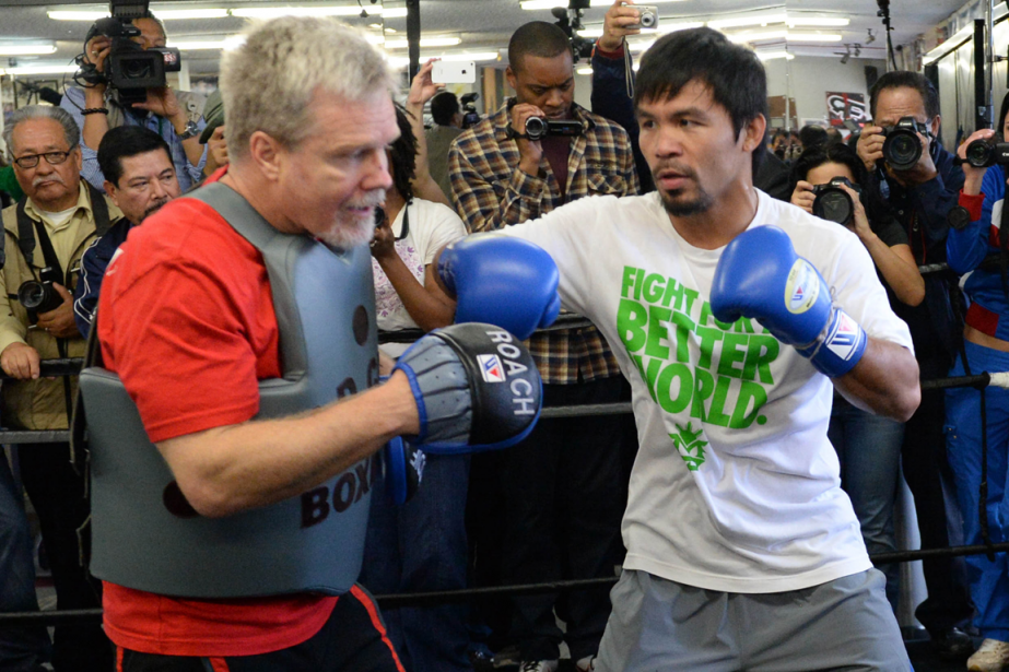 L'entraîneur Freddie Roach et le boxeur Manny Pacquiao.... (Photo archives USA Today)