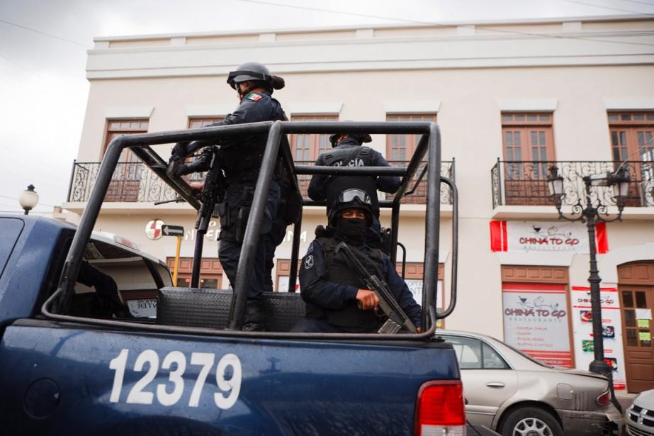 Des policierspatrouillent dans les rues deMatamoros, en juin... (PHOTO ARCHIVES THE NEW YORK TIMES)