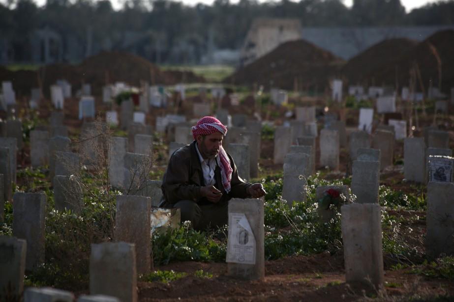 La guerre syrienne a coûté la vie à... (PHOTO ABD DOUMANY, AFP)