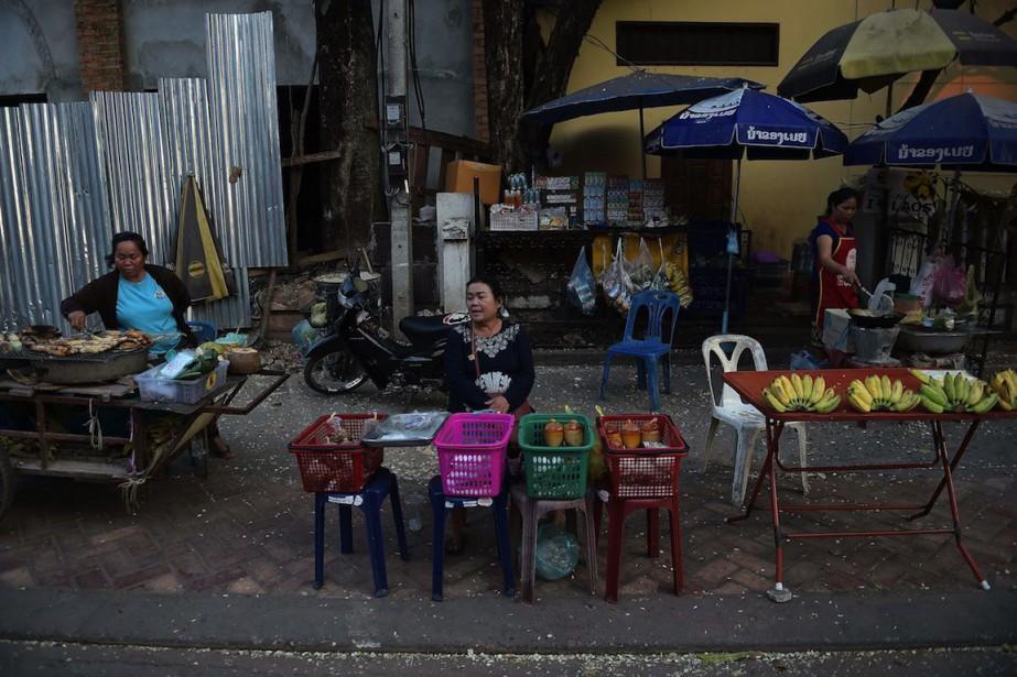 Tenu par un régime communiste autoritaire, le Laos... (PHOTO CHRISTOPHE ARCHAMBAULT, ARCHIVES AFP)