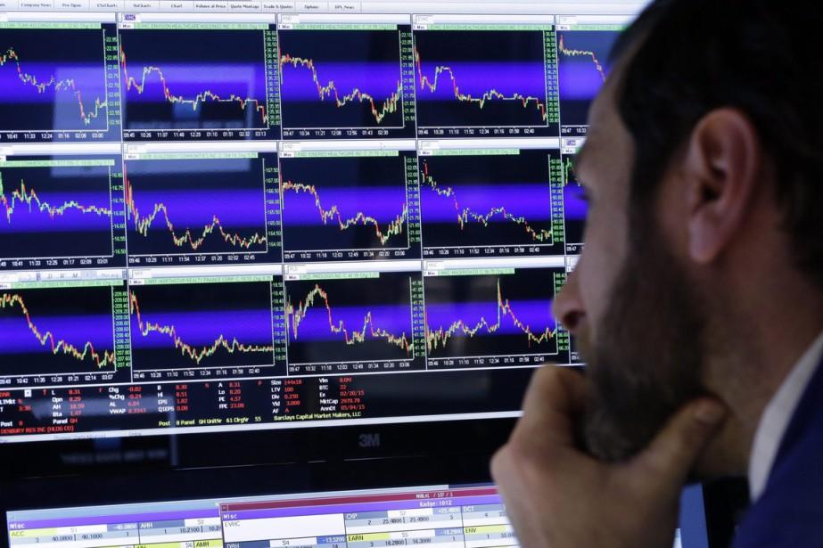 Malgré les services de «robots-investisseurs»,les conseillers financiers affirment... (Photo Richard Drew, AP)