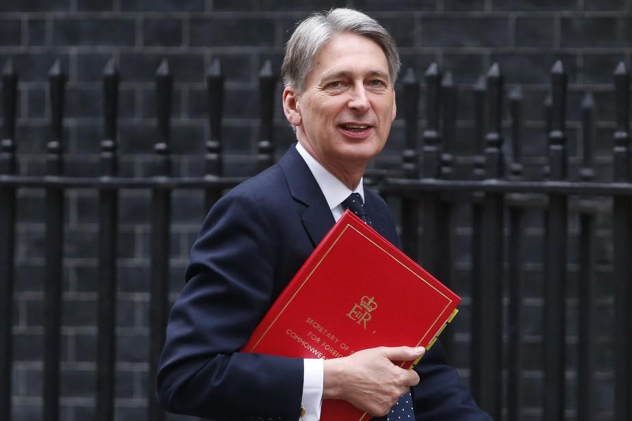 Le ministre des Affaires étrangères du Royaume-Uni, Philip... (PHOTO SUZANNE PLUNKETT, REUTERS)