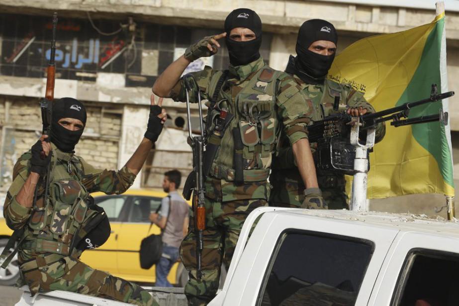 Les cris hostiles de «Mort aux Baassistes» ont... (PHOTO SABAH ARAR, AFP)