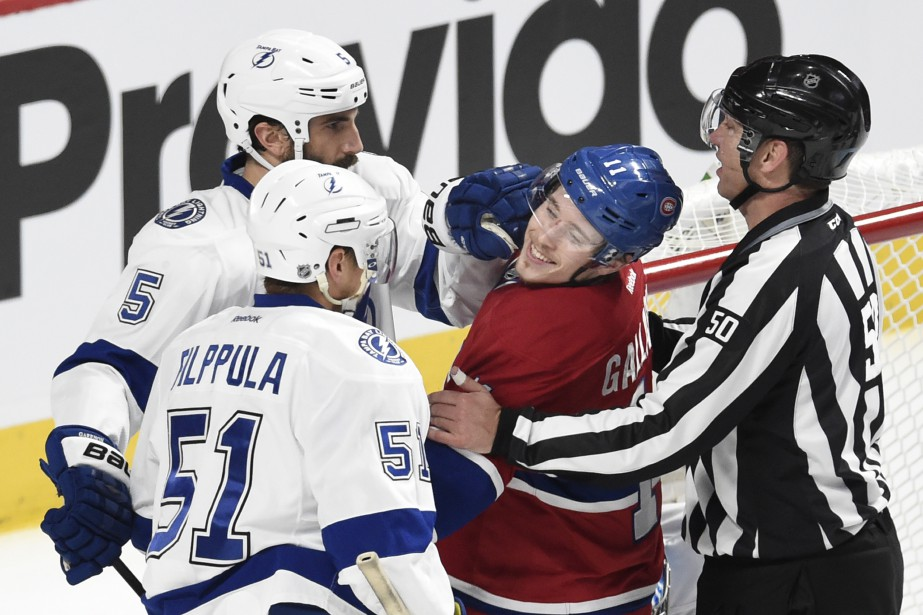 Brendan Gallagher nargue Jason Garrison devant le but du gardien du Lightning Ben Bishop. ()