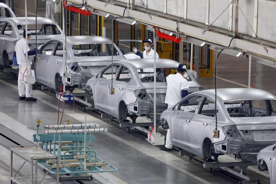 Une usine de montage en Chine... (PHOTO AP)