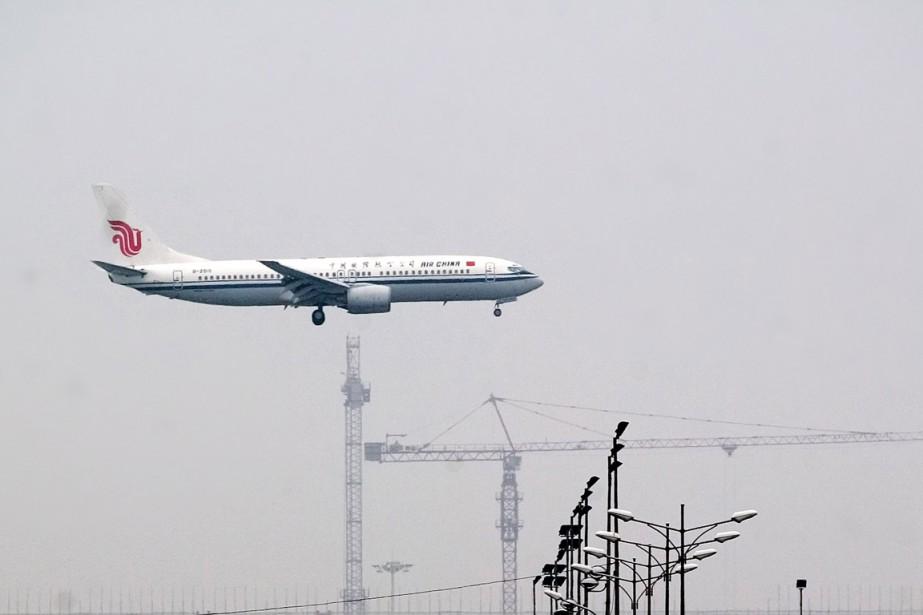 Un avion de Air China se pose à... (Photo Bernardo De Niz, Bloomberg)