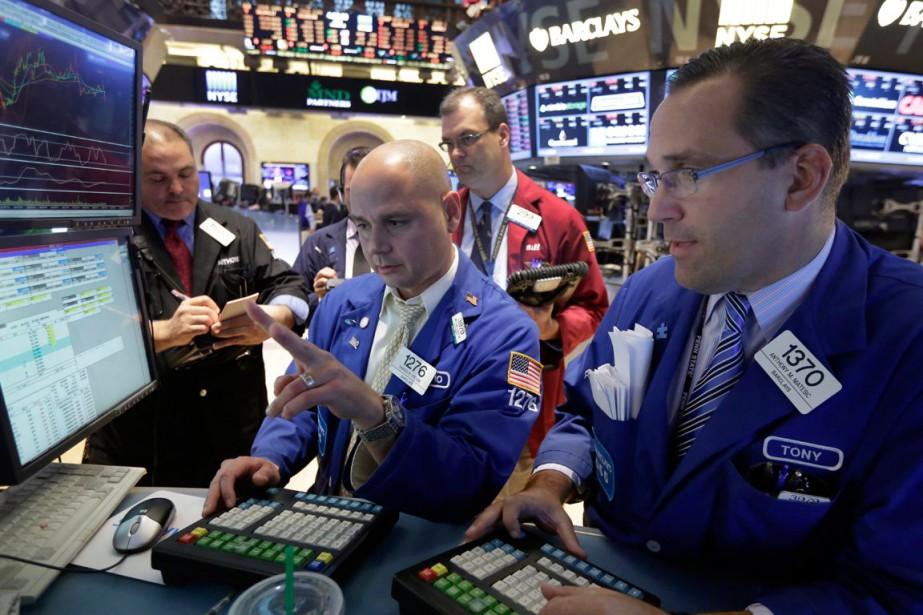 Wall Street a fini la séance mardi en léger... (PHOTO RICHARD DREW, ARCHIVES AP)